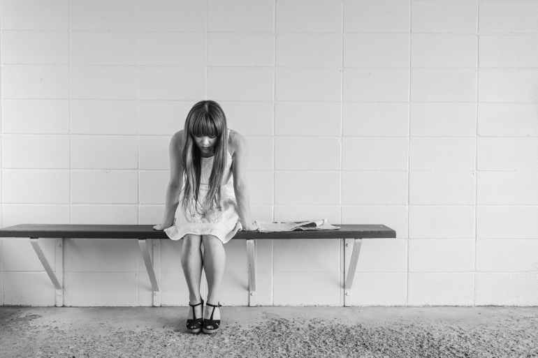 a girl feeling guilty and sad